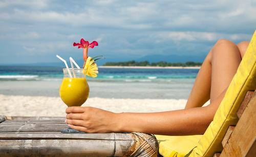 woman-having-cocktail-beach